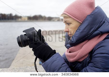 Elderly Mature Senior Woman Tourist Photograph Shooting, Taking A Picture, Photo, Looking On Slr Mir