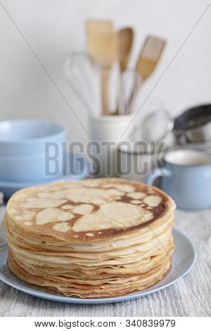 Cooking Pancakes. Shrovetide (maslenitsa) - Blini Stack On A Blue Plate On A Wooden Table. Selective