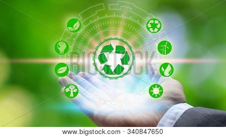 Hand Holding And Protection With Environment Icons Over The Network Connection On Nature Background,