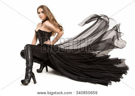 Fashion Model Sitting In Black Dress, Fashion Model Corset Dress Leather Boots High Heels On White