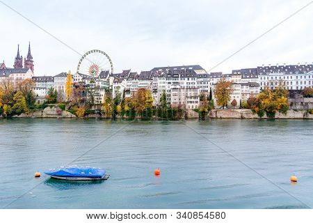 Basel, Switzerland - November 11th, 2018: View Of Basel And Its Cityscape Through Rhine River, And A