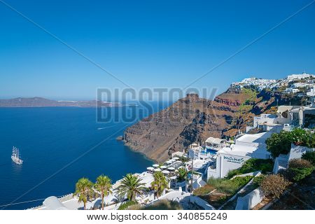 Santorini Greece - August 8 2019; Severe Rocky Hillsides And Headland On Greek Island With Character