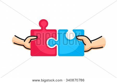 Connect Two Puzzle Pieces. Hands Putting Two Puzzle Pieces Together. Family Concept.