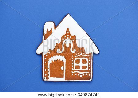 The Hand-made Eatable Gingerbread House On Blue Background