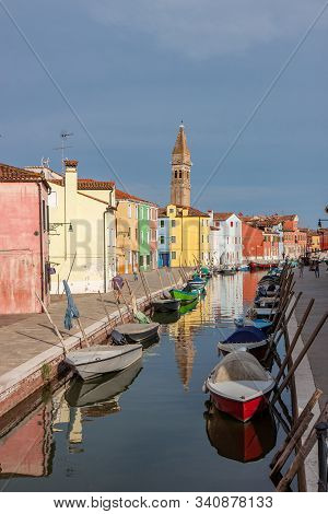 Colorful Buildings Line A Canal In Burano Italy