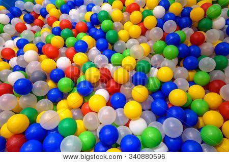Balls In Playground For Colorful Background. Dry Plastic Pool With Many Small Balls For Play. Patter