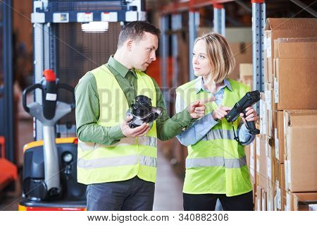 Warehouse service and Management System. Worker with barcode scanner