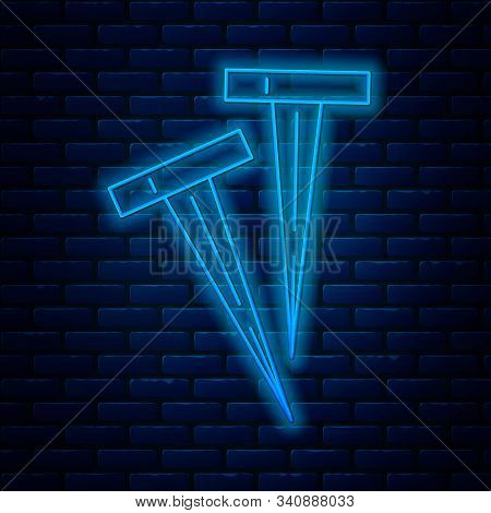 Glowing Neon Line Pegs For Tents Icon Isolated On Brick Wall Background. Extreme Sport. Sport Equipm
