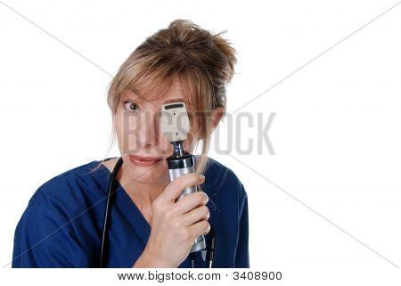 Middle Aged Female Doctor Doing Eye Exam
