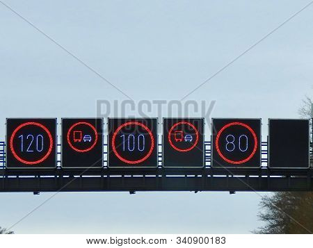 Speed Limit Signs On German No Limit Autobahn 80, 100, 120 Km Per Hour According To Lines, Overtakin