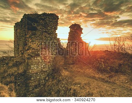 Broken Church Or Stronghold Walls On Peak Above The Forest.