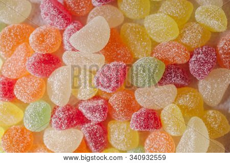 Colorful Jelly Candies With Sugar. Close Up View Of Fruity Jelly Candies As Background. Sugar Candie