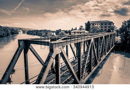 Iron Railway Bridge Over The Dora Baltea River In Ivrea City, Torino, Region Piemonte, Italy