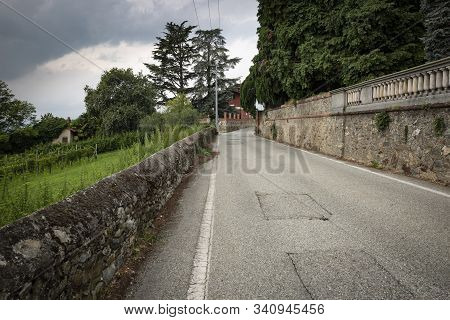 Secondary Paved Road In Piverone, Turin, Region Piemonte, Italy