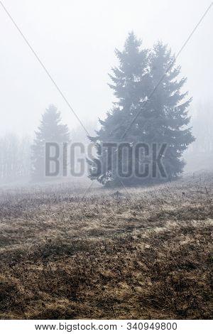 Foggy Landscape In Strazov Hill, Strazov Mountains In Slovak Republic. Seasonal Natural Scene.
