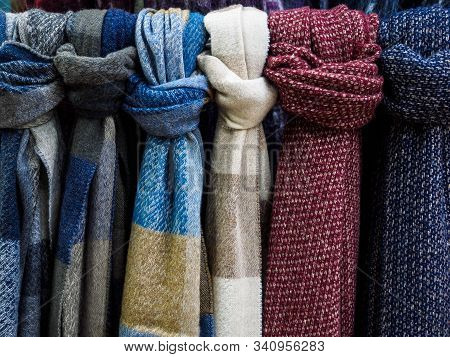 Wool Scarves Hang In The Shop Window. Colorful Scarves Tied In A Knot.