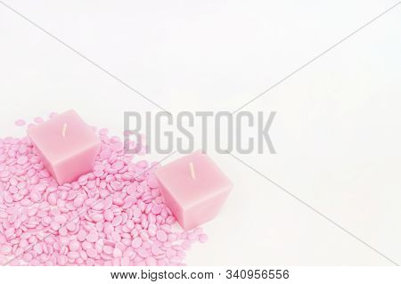 Background Texture Wax For Depilation Of Pink Color On A White Background With Candles. Space For Yo