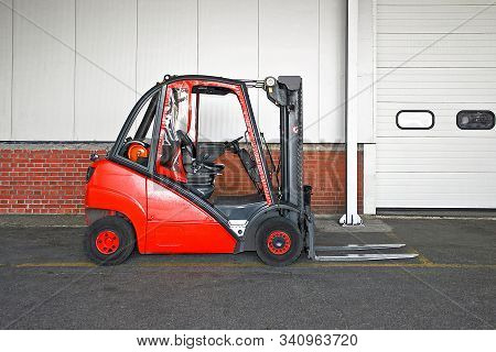 Big Red Fork Lifter Truck In Storehouse