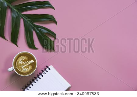 A Cup Of Coffee With Note And Copy Space On Pink Background. Food And Drink Concept.