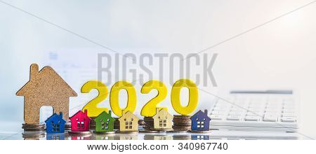 House Model And Wood Block 2020. Buying A Home With A Small Family, Affordable Housing. Mortgage Pro