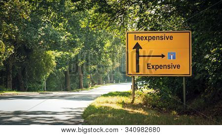 Street Sign The Direction Way To Inexpensive Versus Expensive