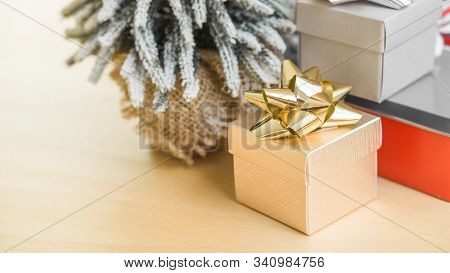 Gift Box And Happy New Year Concept - Gold Gift Box On Wood Table In Happy New Year And Christmas Ev