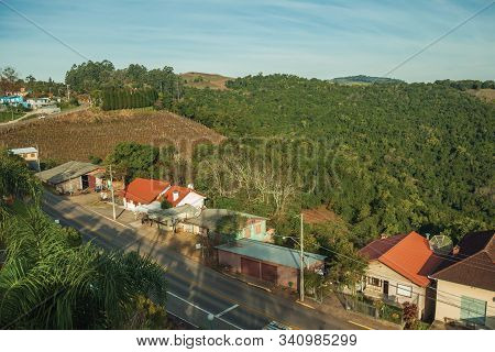 Roadside Houses On A Small Countrified Village In A Hilly Region Covered By Forests Near Bento Gonca