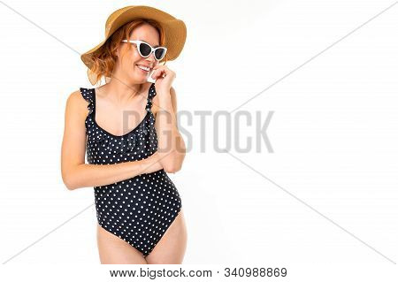 Beautiful Girl In A Retro Bathing Suit And A Straw Summer Hat And Sunglasses On A White Background W