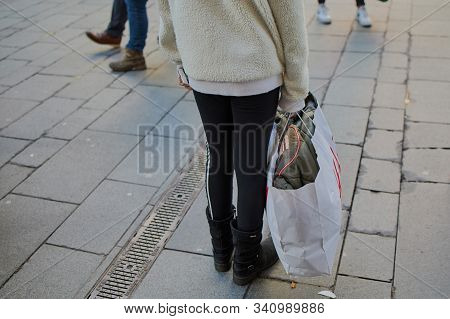 Mainz, Germany - December 21, 2019: Lower Body Of A Girl In The City Of Mainz With Shopping Bag In T