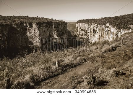 Dirt Pathway At The Itaimbezinho Canyon With Steep Rocky Cliffs Near Cambara Do Sul. A Small Country