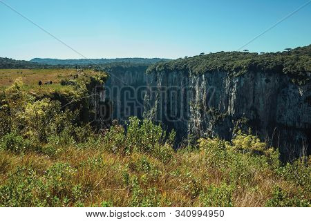 Itaimbezinho Canyon With Steep Rocky Cliffs Going Through A Flat Plateau Covered By Forest Near Camb