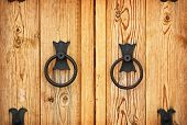 Metal handles on the old-fashioned wooden doors poster