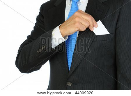 Closeup of a businessman taking a business card from the breast pocket of his suit jacket. Hand and torso only, man is unrecognizable. Horizontal format on a white background.