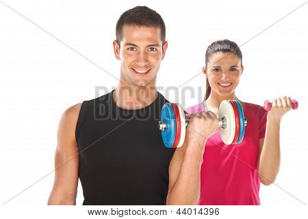 Young Man And Woman Lifting Weights. Isolated On White