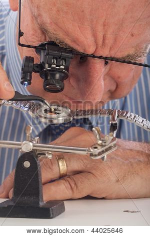 Close-up Of Man Repairing Wrist Watch