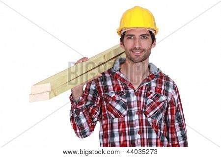 Tradesman carrying wooden planks