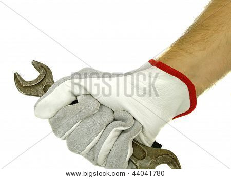 Hand holding spanner