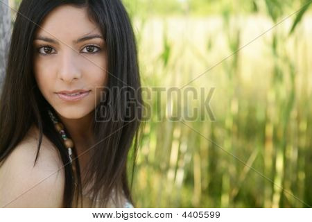 Portrait Of Beautiful Indian Woman On Nature