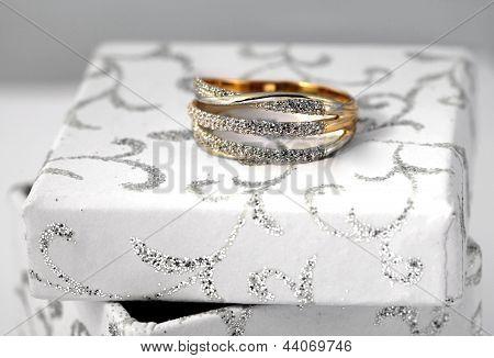 Golden Jewelry On White Box