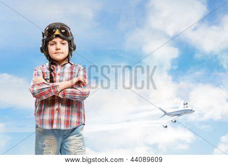 Boy in helmet pilot dreaming of becoming a pilot