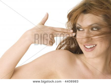 Beautiful Topless Redheaded Woman Smiling Happliy With Fingers To Her Head