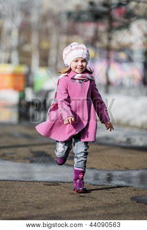 Young Girl Running At Walkway