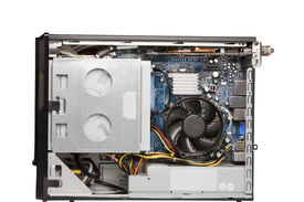 Open casing with the interior layout of a personal computer showing the positioning of components the wiring and the fan