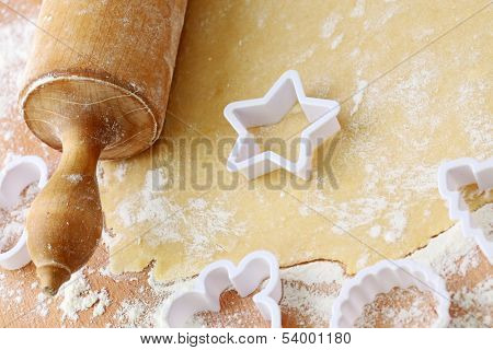 Rolling pin and shortcrust pastry on table poster