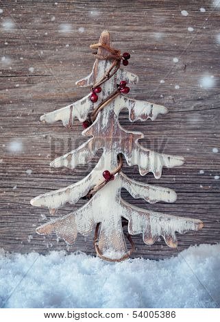 Wooden christmas tree on wooden background