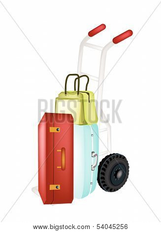 Hand Truck Loading Stack Of Luggages And Bag