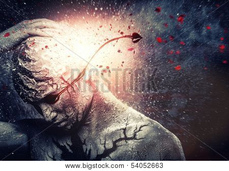 Man with conceptual spiritual body art and bloody tears