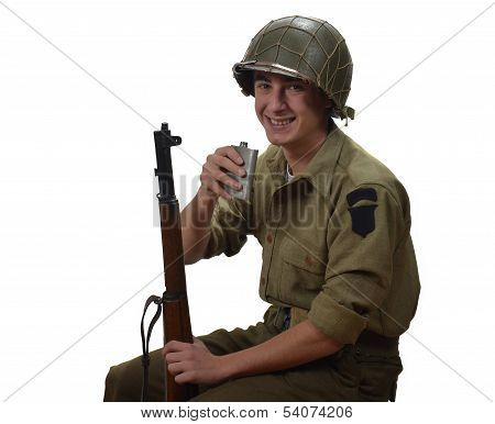 Young American Soldier Takes A Sip Of Alcohol