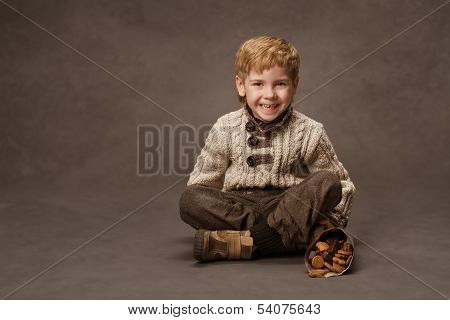 Child Smiling In Knitted Sweater. Boy Fashion In Retro Style. Brown Background