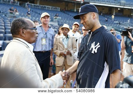 BRONX, NY-JUNE 1; Supercentenarian Bernardo LaPallo, who is 111 years old, shakes hands with New York Yankees shortstop Derek Jeter (R) before the game on June 1, 2013 at Yankee Stadium in the Bronx.